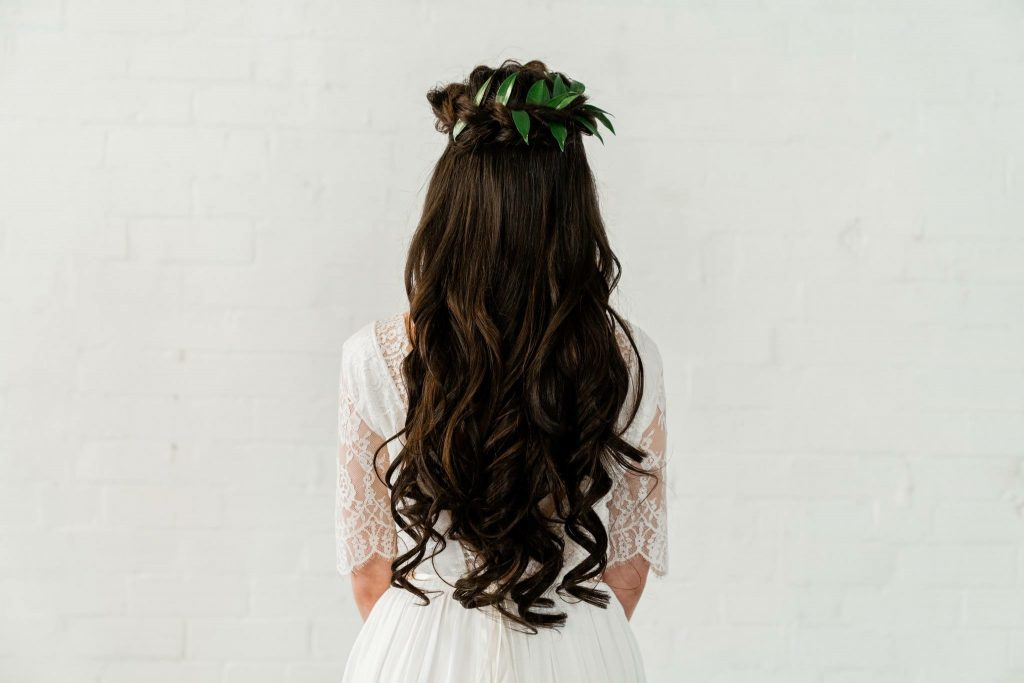Bohemian curls and foliage adorned crown braid.
