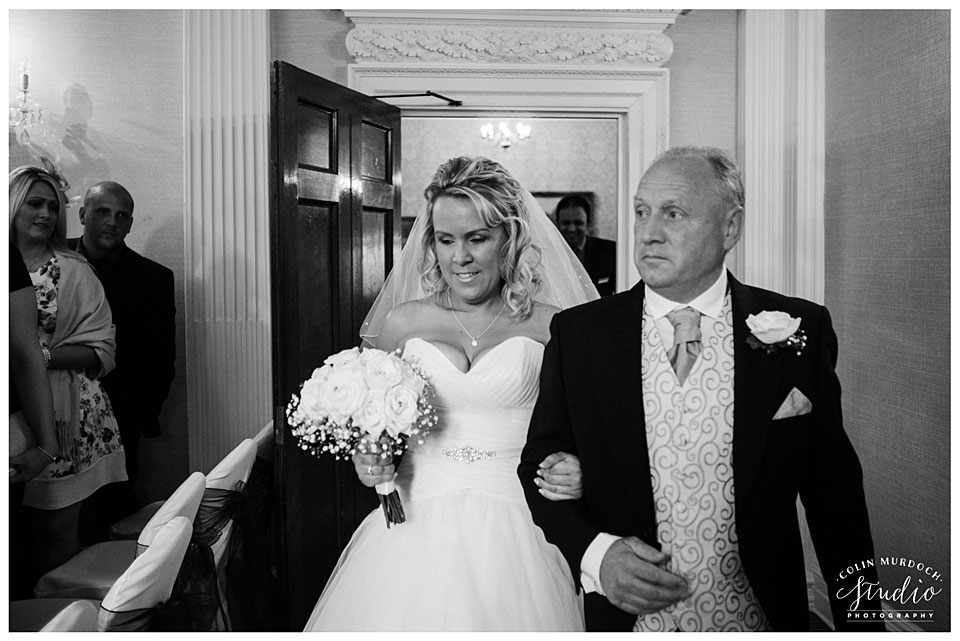 Bride walking down the aisle at Aldwark Manor wedding venue