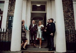 Bride and groom outside York Registry Office after a wedding ceremony